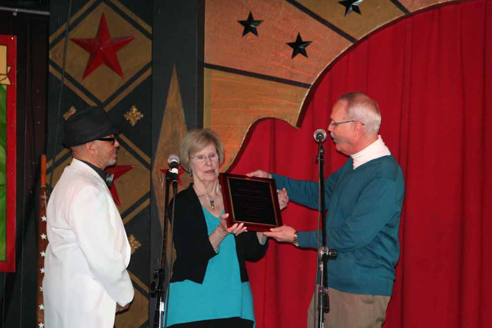 Presenting Gaynel Hodge with a plaque.  Photo by Marian Cicerale.